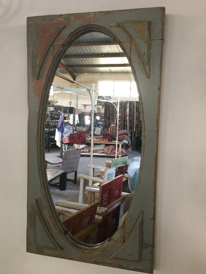 mirror in an old window frame