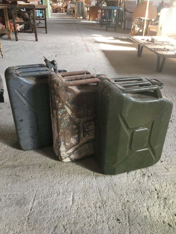 Old greek petrol canister, antique metal oil greek army gas container