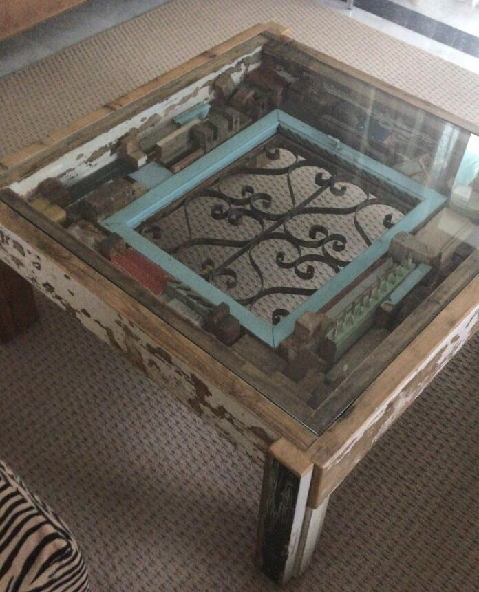 Coffee table made of old woods and greek old rail, balcony
