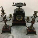 Antique utensils three pieces set, clock and candle sticks