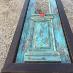 Lunch table made with an old greek door from the previous century in a wooden frame