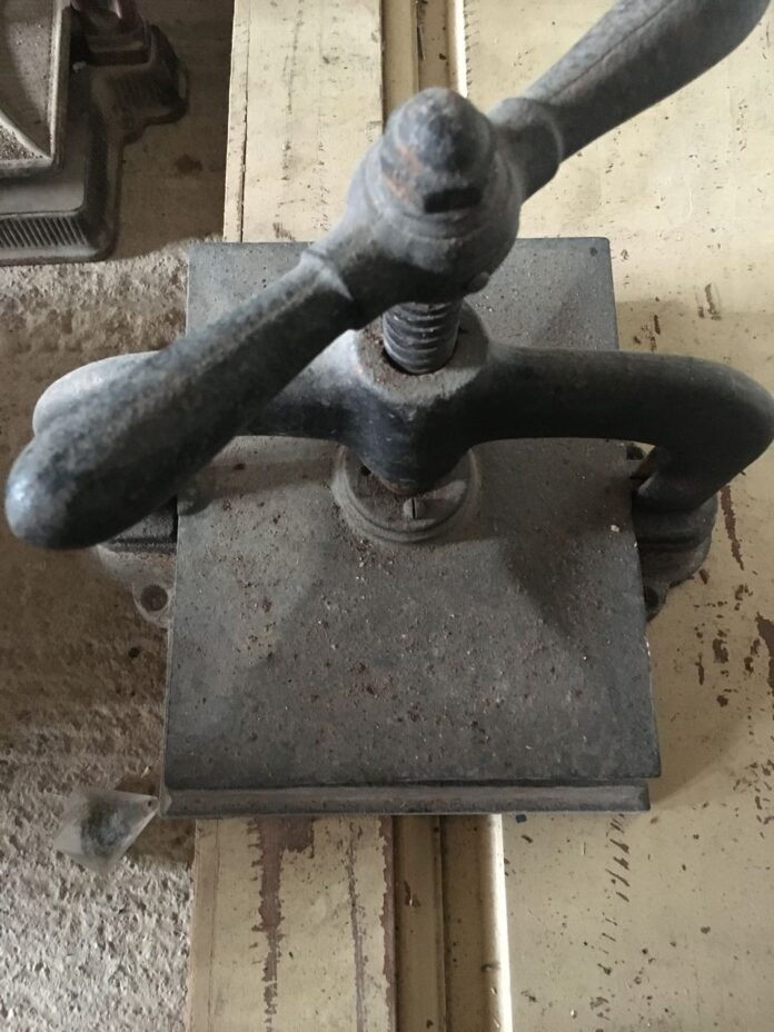 Printing press, old greek machine for use or vintage decor, solid, heavy construction,